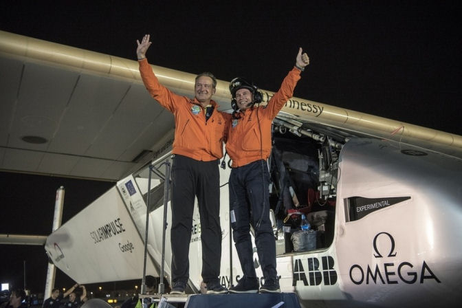 Andre Borschberg welcomes Bertrand Piccard to Abu Dhabi after Solar Impulse 2 landed in Al Bateen Airport in Abu Dhabi.(Photo/Solar Impulse/Chammartin Rezo)