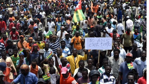 Protesters carry flags and placards while they march shouting slogans as they call for reforms during an anti-government rally in Lome on September 6, 2017. (Reuters/Noel Kokou Tadegnon)