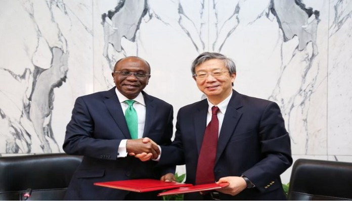Governor Emefiele of the CBN and Governor Yi of the People's Bank of China signed the currency swap agreement between both countries. (AFP)