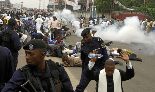 Congolese riot police fire tear gas to disperse demonstrators during a protest against President Joseph Kabila, in Kinshasa on January 21 2018.(REUTERS)