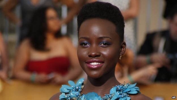 Actress Lupita Nyong'o arrives at the 20th annual Screen Actors Guild Awards in Los Angeles, California, on  January 18, 2014. (AP)