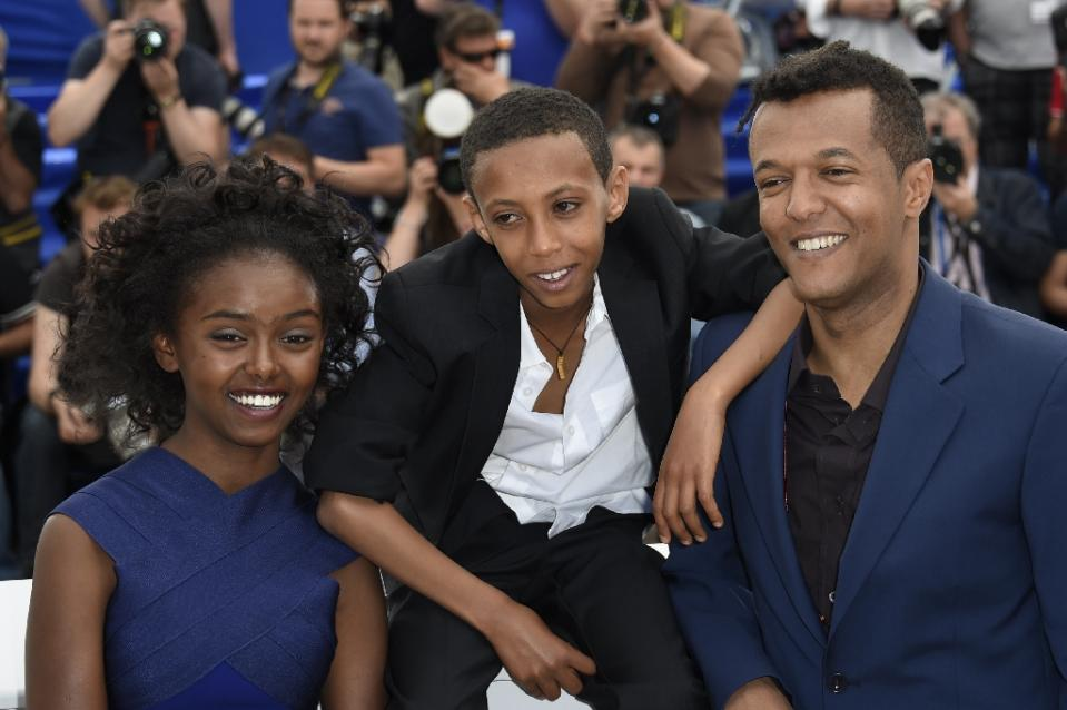 File - May 20, 2015. Ethiopian actress Kidist Siyum,(L) actor Rediat Amare (C) and director Yared Zeleke (R) pose during a photocall for the film Lamb at the 68th Cannes Film Festival in Cannes, southeast France, on May 20, 2015 (Photo/AFP/Loic Venance)