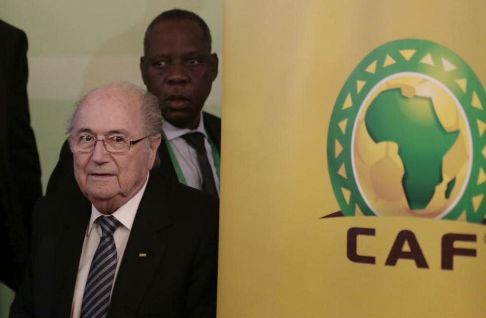 FIFA President Sepp Blatter, left, and Confederation of African Football President Issa Hayatou, back, in Cairo, Egypt, April 7, 2015. (Photo/AP/Hassan Ammar)