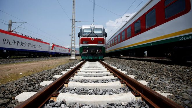 Locomotives for the new Ethiopia to Djibouti electric railway system queue outside a train station in the outskirts of Addis Ababa. (AFP)