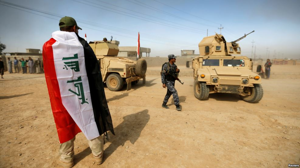 A soldier wears an Iraqi flag after the liberation of Khalidiya village from Islamic State militants south of Mosul, Iraq, October 20, 2016. (Reuters)