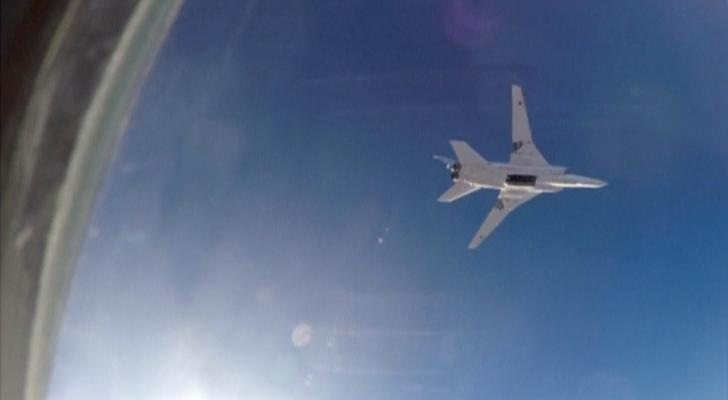 A still image, taken from video footage and released by Russia's Defence Ministry on August 16, 2016, shows a Russian Tupolev Tu-22M3 long-range bomber based in Iran, flying after bombs were dropped off, at an unknown location in Syria.(Photo/Reuters)
