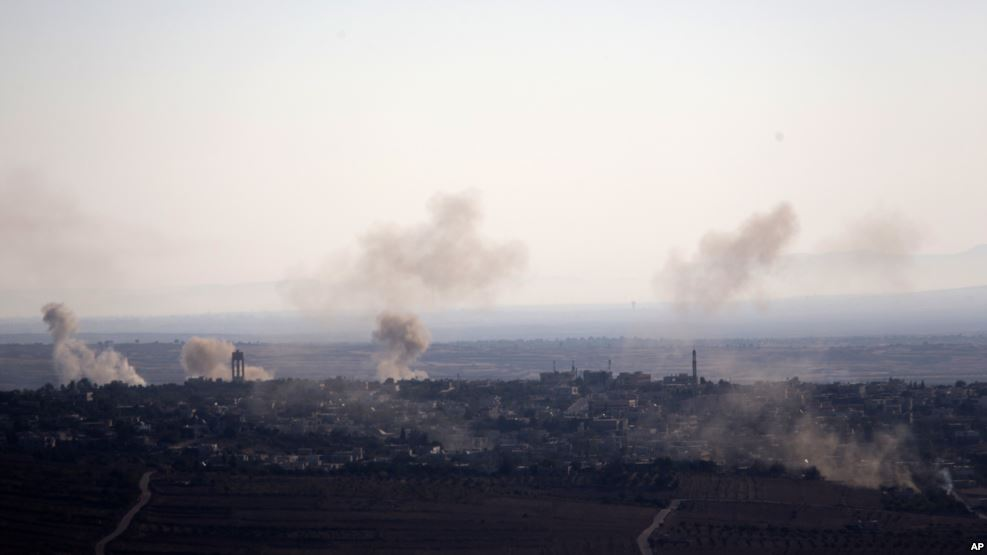 Smoke and explosions from the fighting between forces loyal to Syrian President Bashar Assad and rebels rise in the village of Jubata al-Khashab as seen from the Israeli-controlled Golan Heights, September 11, 2016. (AP)