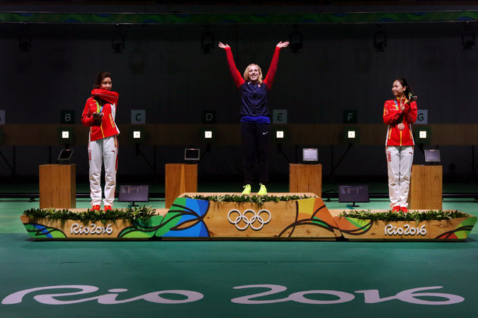Virginia Thrasher, center, after winning a gold medal. at Rio Olympic Games 2016. (Photo/The New York Times/Chang W Lee)