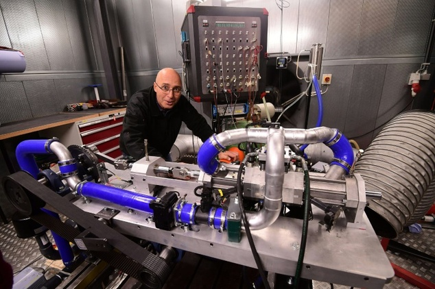 Shaul Yakobi, inventor and co-founder of Aquarius Engines, poses next to a single piston combustion engine invented by the firm to drastically reduce fuel consumption ©Emmanuel Dunand (AFP)