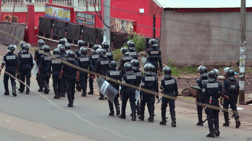 Cameroon police officials walk with riot shields on a street in the administrative quarter of Buea some 60kms west of Douala, October 1, 2017. (AFP)