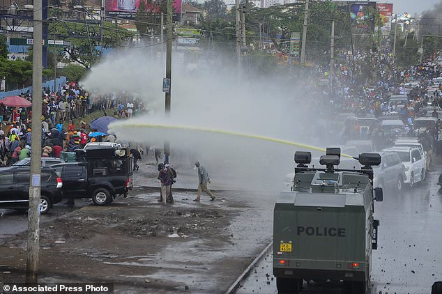Kenyan opposition supporters are spayed with water in Nairobi, Kenya,November 17, 2017.(AP)