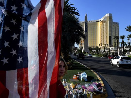 The US flag is left at a makeshift memorial outside the Route 91 music festival site beside the Mandalay Hotel October 4, 2017 on the Las Vegas Strip, after a gunman killed 58 people and wounded more than 500 in Las Vegas, Nevada. (AFP/MARK RALSTON)