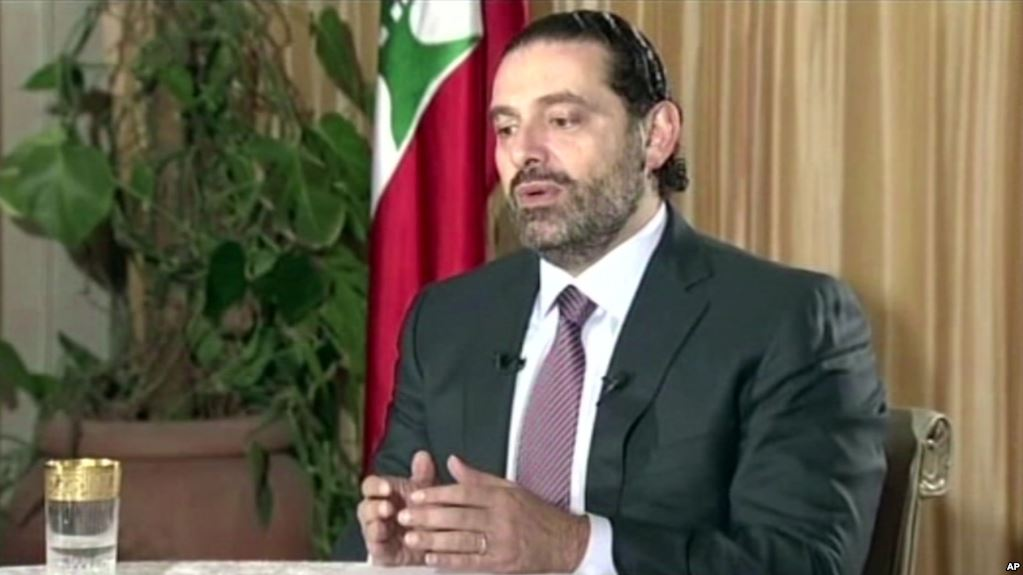 "Lebanon's Prime Minister Saad Hariri gives a live TV interview in Riyadh, Saudi Arabia, Sunday November 12, 2017, saying he will return to his country ""within days"".(AP)"