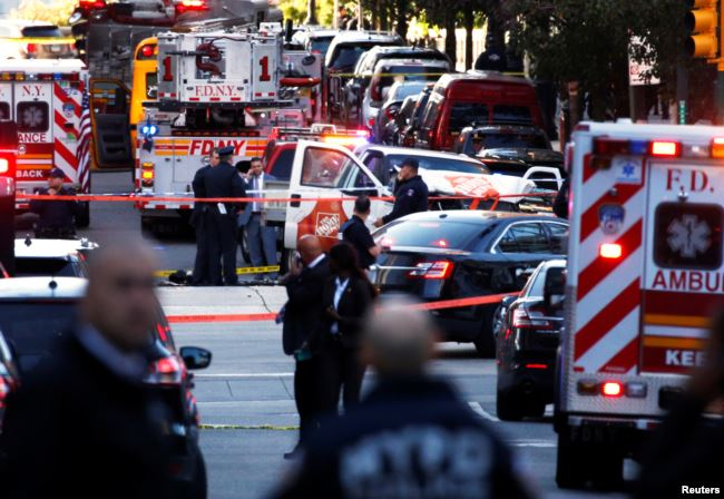 A Home Depot truck which struck down multiple people on a bike path, killing several and injuring numerous others is seen as New York City first responders are at the crime scene in lower Manhattan in New York, October 31, 2017. (Reuters)