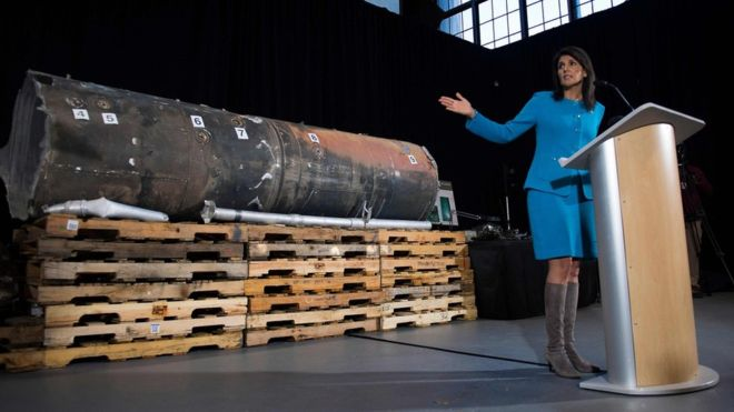 Nikki Haley gestures towards the remnants of a ballistic missile that came close to hitting Riyadh's airport in November, at Joint Base Anacostia in Washington on December 14, 2017. (AFP)