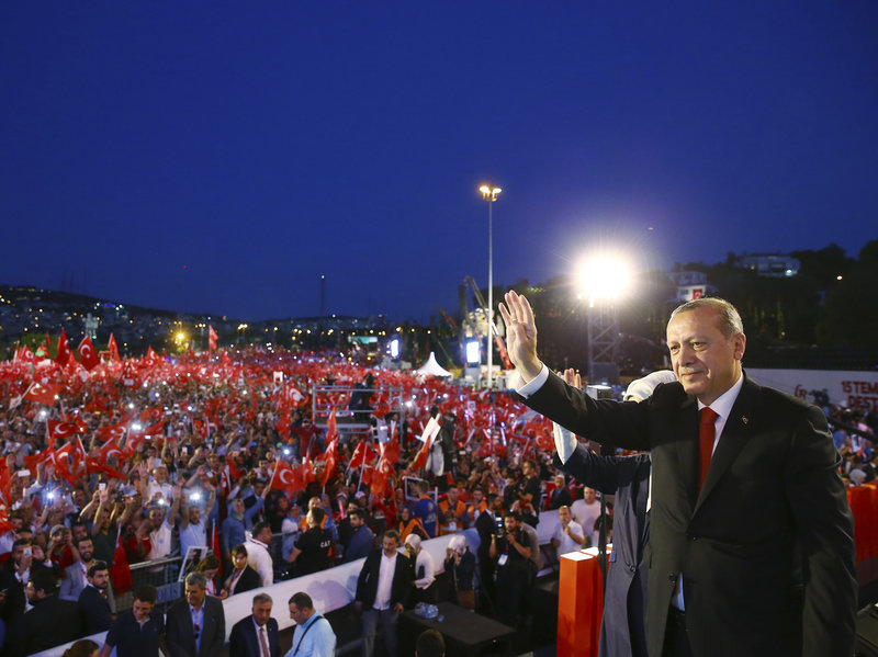 Turkey's President Recep Tayyip Erdogan waves to his supporters as he arrives to commemorate the one year anniversary of the July 15, 2016 failed coup attempt, in Istanbul. July 16, 2017. (AP)