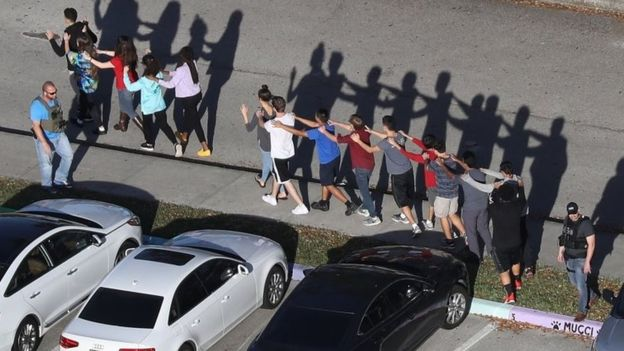 People are brought out of the Marjory Stoneman Douglas High School after a shooting. February 14, 2018. (Getty Images)