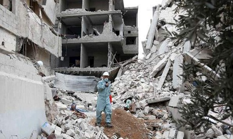 Syrian civil defence volunteer walking through the rubble of a destroyed building in Haza in the besieged Eastern Ghouta region. (AFP)