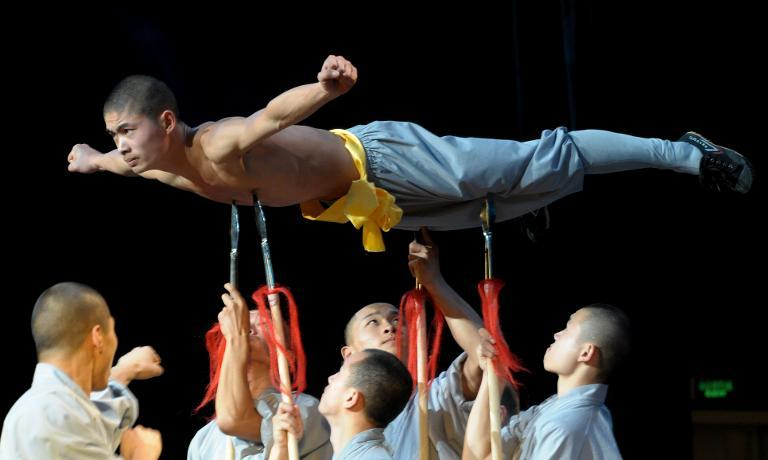 File - January 19, 2014. Buddhist monks from China's Shaolin Temple perform at Dakar's Grand Theatre on January 19, 2014 (AFP/Seyllou)