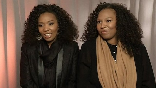 Swati Dlamini, left, and Zaziwe Dlamini-Manaway, granddaughters of Nelson and Winnie Mandela, speak during an interview in New York. (AP Photo/Bebeto Matthews)