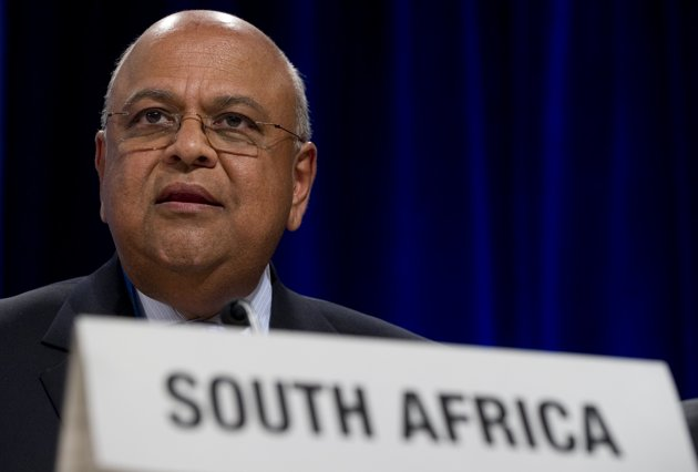 South Africa's Pravin Gordhan speaks during a press conference at the IMF Headquarters in Washington, DC, on September 22. Gordhan on Wednesday urged local companies to do business with other African economies to counter the effects of the debt crisis in the West. (Photo AFP /Saul Loeb)