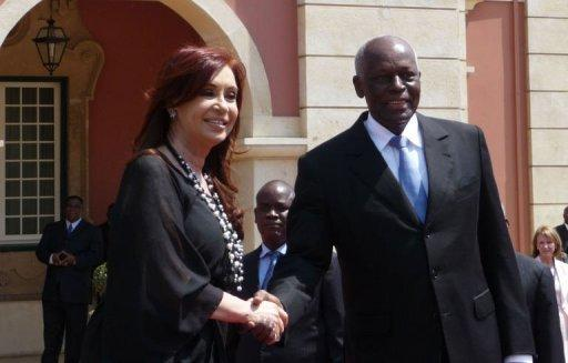 President of Argentina Cristina Kirchner (L) greets Angolan President Jose Eduardo Dos Santos in Luanda. The leaders of Argentina and Angola said Friday they plan to sign new cooperation agreements soon, though Kirchner wrapped up a visit to Luanda with no news on an oil-for-food pact. (Photo AFP/Estelle Maussion)