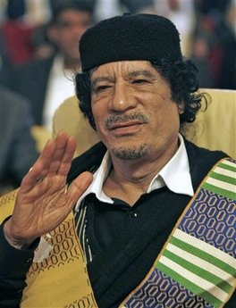 Libyan leader Moammar Gadhafi attends the closing session of the Arab Summit in Doha, Qatar, Monday, March 30, 2009. Libyan leader Moammar Gadhafi stormed out of an Arab summit on Monday after denouncing the Saudi king and declaring himself 'the dean of Arab rulers.' Gadhafi disrupted the opening Arab League summit in Qatar by taking a microphone and criticizing Saudi's King Abdullah, calling him a 'British product and American ally.'  (AP Photo/Hassan Ammar)