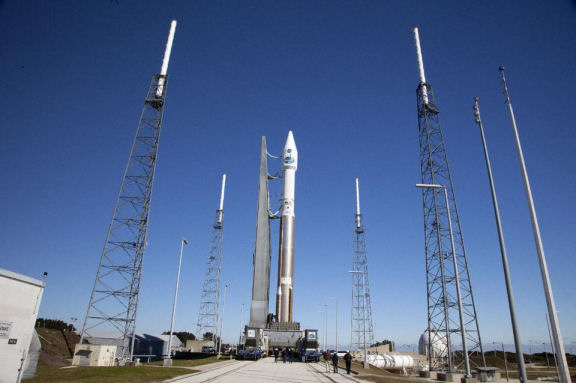 In a photo provided by NASA a United Launch Alliance Atlas V with TDRS-L atop, arrives at the launch pad at Cape Canaveral, Florida, Air Force Station's Launch Complex 41. The unmanned rocket is set to blast off Thursday night, January 23, 2014, with the latest, third-generation Tracking and Data Relay Satellite. (AP/Daniel Casper )