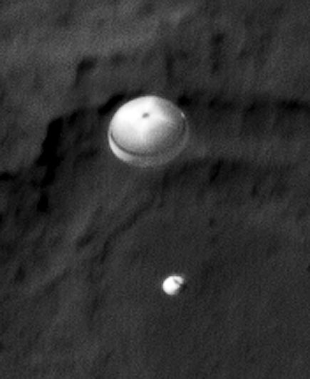 NASA Curiosity rover parachutes to Mars in a photo taken by the Mars Reconnaissance orbiter. (Photo NASA)