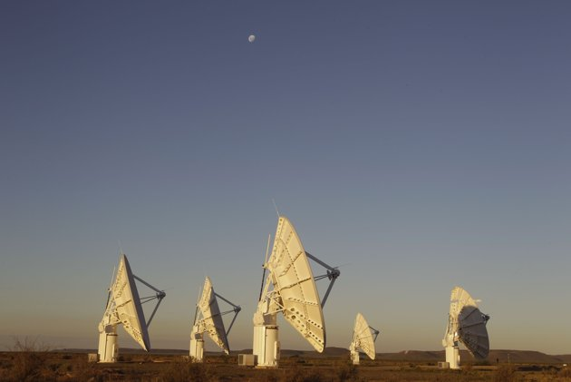This photo taken Tuesday, April 3, 2012, shows telescope dishes near the Karoo town of Carnarvon, South Africa, which is announced Friday May 25, 2012, as the site of the proposed Square Kilometre Array (SKA) radio telescope project. (Photo AP/Schalk van Zuydam)