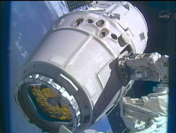 The SpaceX Dragon commercial cargo craft is moved into position for docking with the International Space Station using the station's Canadarm2 in this closeup image captured from NASA TV May 25, 2012. (Image Reuters/NASA TV)