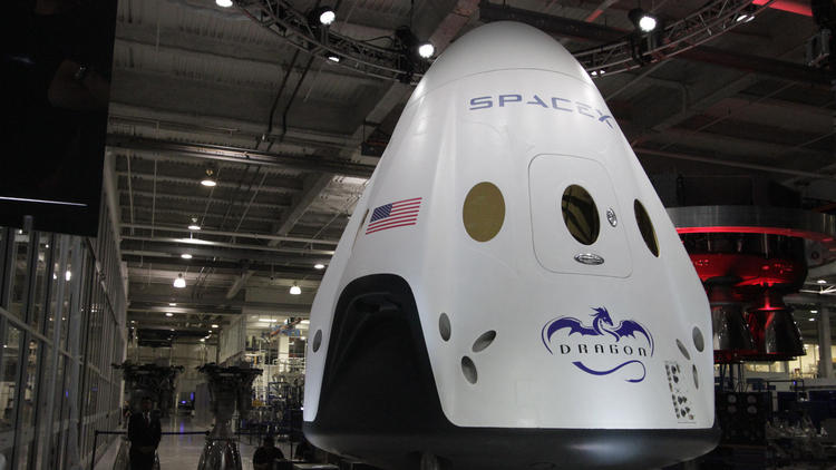 SpaceX's Dragon V2 capsule is designed to carry seven people into space and be reusable. (Lawrence K. Ho/Los Angeles Times)