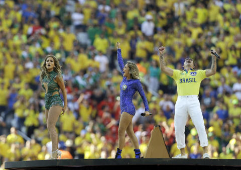 US singer Jennifer Lopez, left, rapper Pitbull and Brazilian singer Claudia Leitte perform during the opening ceremony in the Itaquerao Stadium in Sao Paulo, Brazil,  June 12, 2014. (AP/Kirsty Wigglesworth)