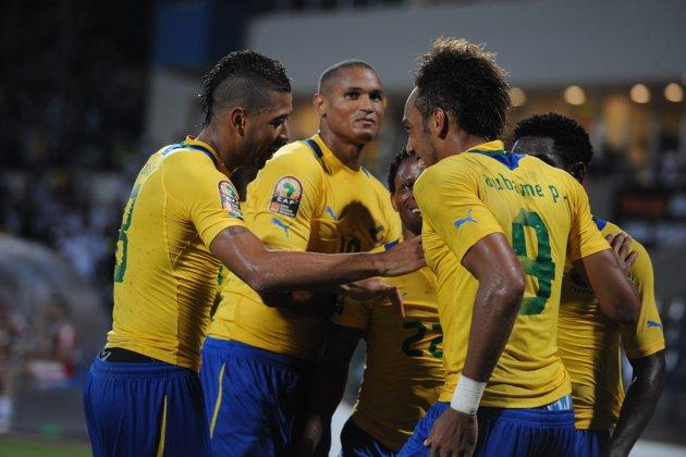 Gabonese players celebrate with teammate Pierre Aubameyang (R) after he scored against Tunisia during their match in the African Cup of Nations in Franceville. Gabon clinched top spot in Group C at the 2012 Africa Cup of Nations Tuesday with a 1-0 victory over Tunisia in a top-of-the-table clash at Stade de Franceville. (Photo AFP /Pius Utomi Ekpei)