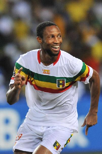 Mali's Seydou Keita celebrates after his team's victory against Gabon during the Africa Cup of Nations quarter-finals at the Stade de l'Amitie in Libreville. Mali beat Gabon 5-4 on penalties here Sunday after this finely balanced Africa Cup of Nations quarter-final ended 1-1 following extra time. (AFP Photo/Issouf Sanogo)