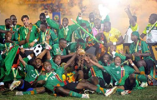 Zambia national team players celebrate their victory with their trophy at the end of the African Cup of Nations final football match between Zambia and Ivory Coast, at the Stade de l'Amitie in Libreville. Zambia won the match during the final penalty shootout. (Photo AFP /Franck Fife)