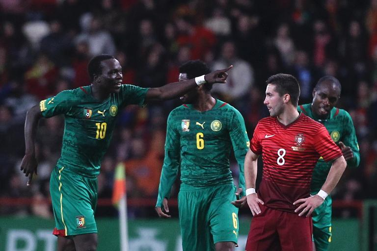 Cameroon's Vincent Aboubakar (L) ,at Magalhaes Pessoa stadium in Leiria, March 5, 2014 (AFP/Pedro Nunes)
