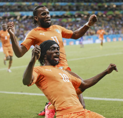 Ivory Coast's Gervinho (10) celebrates along with teammate Didier Drogba (11) at the Arena Pernambuco in Recife, Brazil, June 14, 2014. (AP/Petr David Josek)