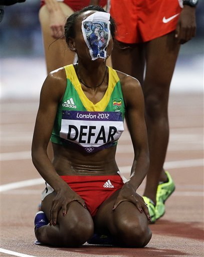 Ethiopia's Meseret Defar reacts after her win the 5000-meter final during the athletics in the Olympic Stadium at the 2012 Summer Olympics, London, Friday, Aug. 10, 2012.(AP Photo/Lee Jin-man)