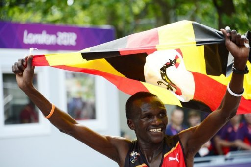 Uganda - Stephen Kiprotich seconds before crossing the finish line to win the Olympic marathon in London on August 12. Kiprotich stunned a strong Kenyan team to win the men's Olympic marathon on Sunday, handing his east African nation only their second ever gold medal. (Photo AFP/Daniel Garcia)