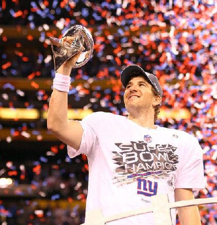 Eli Manning #10 of the New York Giants hoist the Vince Lombardi Trophy after defeating the New England Patriots in Super Bowl XLVI at Lucas Oil Stadium on February 5, 2012 in Indianapolis, Indiana. The New York Giants defeated the New England Patriots 21-17. (Photo Getty Images by Al Bello)