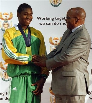 South Africa's President Jacob Zuma, right, congratulates athlete Caster Semenya, left, during their meeting at The Presidential Guest House in Pretoria, South Africa, Tuesday Aug. 25, 2009. Semenya, who is undergoing gender testing after questions arose about her muscular build and deep voice, returns home Tuesday to celebrations after her 800-meter win at the world championships. (AP Photo/Themba Hadebe)